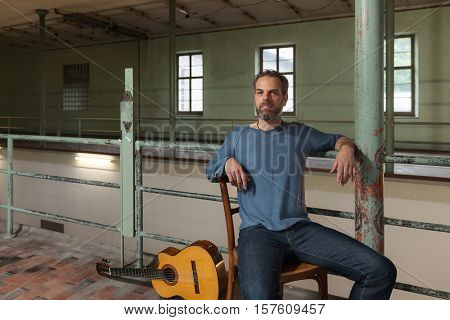 portrait of man grizzled, old industrial space background