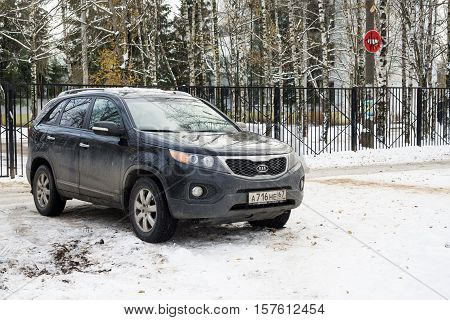 Smolensk, Russia - November 13, 2016: Crossover KIA parked in winter street in criminal district.