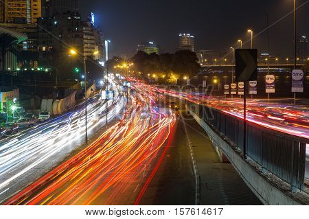 Cairo Egypt - November 12 2016: Traffic light trails on the Corniche El Nile Street at rush hour in Cairo city center.
