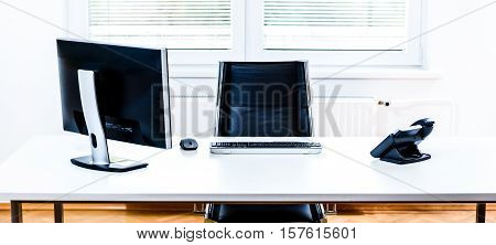 Modern Empty Office Space Desk With Computer, Phone And Chair.