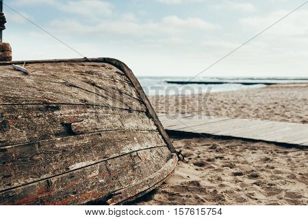 Old Wooden Boat Upside Down On The Beach