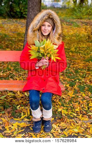 Preteen Girl In Autumn Park With Leafs