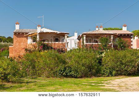Baia Sardinia Italy - September 29 2009: Typical villas on the shores of the Mediterranean at Baia Sardinia (Baja Sardinia) Sardinia Italy.
