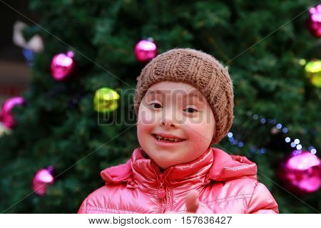 Young girl on background of the Christmas tree