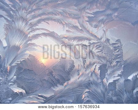 Beautiful ice pattern on winter glass close-up texture