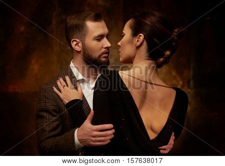 Portrait of well-dressed couple in expression of feelings
