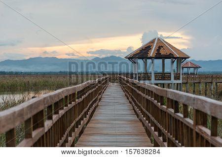 Sunset long wooden bridge in Sam Roi Yot National Park Prachuap Khiri Khan Thailand