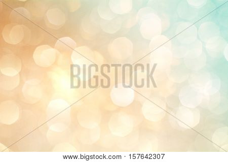 Festive abstract background with bokeh lights. Gold and blue bokeh background of Christmas Lights.