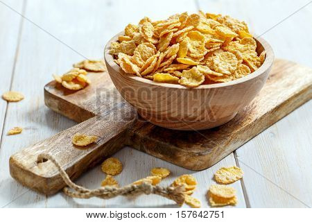 Corn Flakes In A Wooden Bowl.