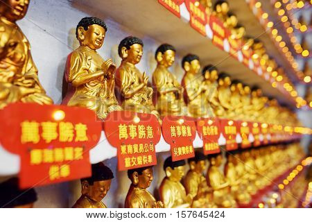Different Small Golden Buddha Statues In The Interior Of The Ten Thousand Buddhas Monastery