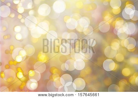 defocused bokeh christmas lights background in different pastel colors and circle shapes