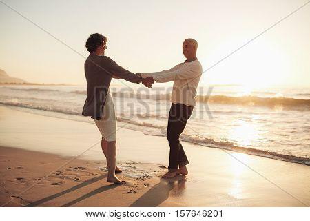 Senior Couple Enjoying Their Retirement On The Beach