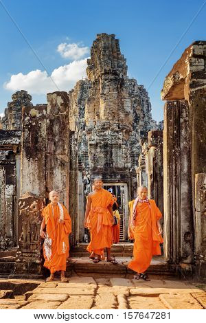 Young Buddhist Monks Coming Out Of Bayon Temple, Angkor Thom