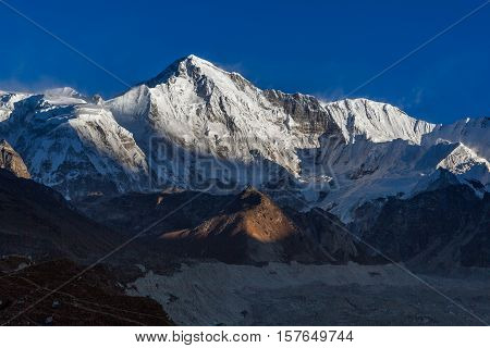 Cho Oyu Mountain Ridge Lit Up By The Sun Lights Before Sunset. Beautiful Landscape High In The Himal