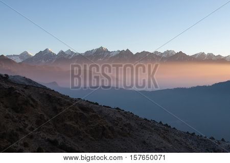 Misty Mountain Sunrise Landscape In Himalayas, Nepal. Misty Mountains Scenery With High Altitude Pea