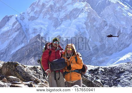 Portrait of couple trekkers at high himlaya mountain