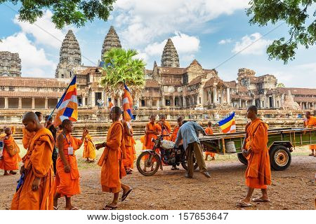 Young Buddhist Monks With Flags In Ancient Angkor Wat, Cambodia
