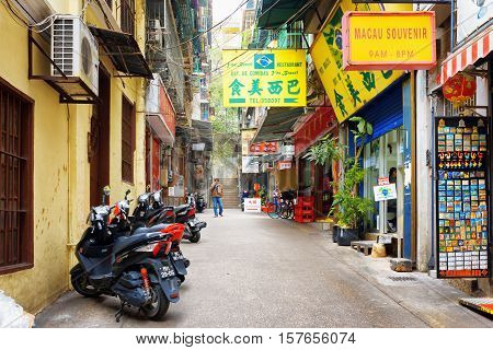 The Parking Of Motorbikes And Souvenir Shop On The Street In Macau