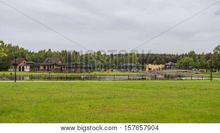 BELGOROD RUSSIA - June 13 2016: Belgorod zoo. Walkup and the bridge across the pond. General form.