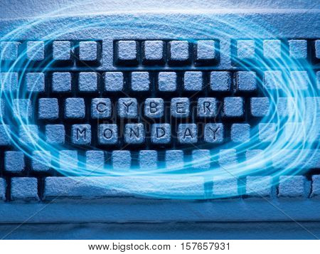 computer keyboard with words Cyber Monday illuminated with blue light