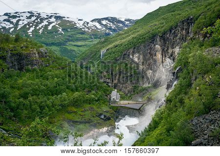 Kjosfossen famous waterfall view from upper point. Popular touristic attraction and hiking route. Flam, Aurland, Norway