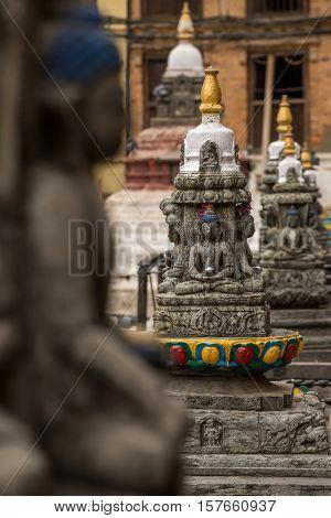 Buddha statue on the square near Swayambhunath stupa in Kathmandu valley, Nepal