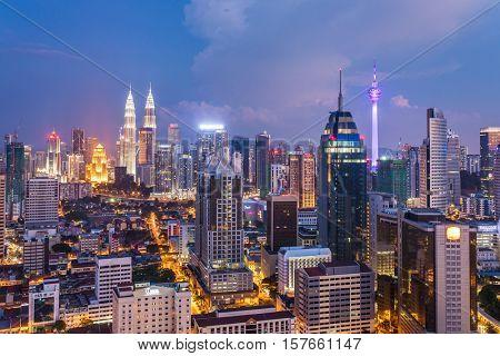 Kuala Lumpur, Malaysia - September 24, 2016: Kuala Lumpur city view with famous Petronas towers and Menara KL tower, Malaysia