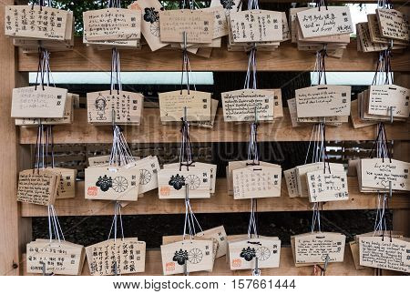 Meiji Jingu Shrine, Shibuya, Tokyo, Japan - December 6, 2015: A Japanese votive plaque (Ema) hanging in Meiji Jingu Shrine. Ema are small wooden plaques used for wishes by shinto believers