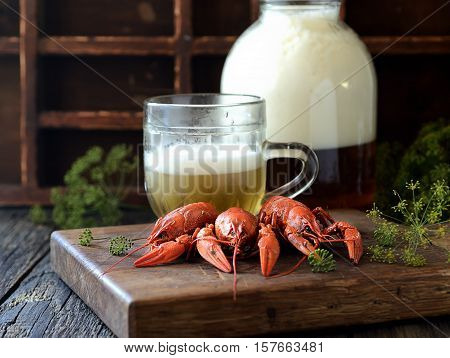 boiled crawfish and beer on a wooden background. rustic style