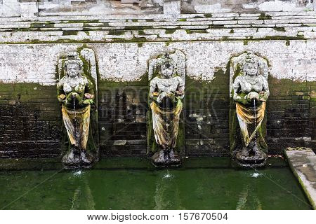 Bathing temple figures at the Pura Goa Gajah Temple (The Elephant Cave Temple) in Ubud, Bali, Indonesia