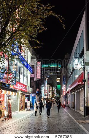 Tokyo, Japan - December 6, 2015: Pedestrians walking in the streets of Shinjuku, Tokyo, Japan at night