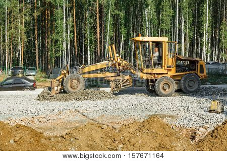 Grader Working Outside On Road Construction