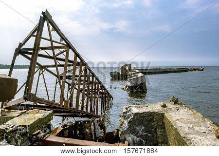 Sosnoviy Bor.Russia.25 july 2016.Abandoned rusty metal pier in the Gulf of Finland in Leningrad region
