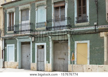 Old abandoned and disused building boarded up in Valencia Spain