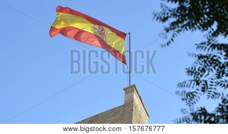 The national flag of Spain flying from the Serranos Tower (Torres de Serranos) in Valencia Spain