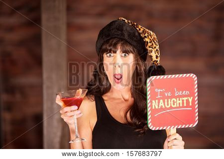 Shocked Woman Holding A Drink And Naughty Sign