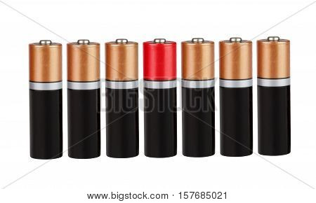 Seven batteries of the type AAA in a single row, one red, on white background, isolated