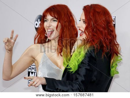Dani Thorne and Bella Thorne at the 2016 American Music Awards held at the Microsoft Theater in Los Angeles, USA on November 20, 2016.