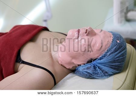 Woman Lying With Peel Off Face Mask