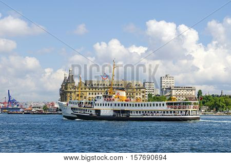 Istanbul Turkey - June 6 2013: Istanbul ferry and Haydarpasa railway station. Istanbul Haydarpasa Terminal or Haydarpasa Terminus (Turkish: Haydarpasa Gari) is a railway terminal in Istanbul. Until 2012 the station was a major intercity regional and commu