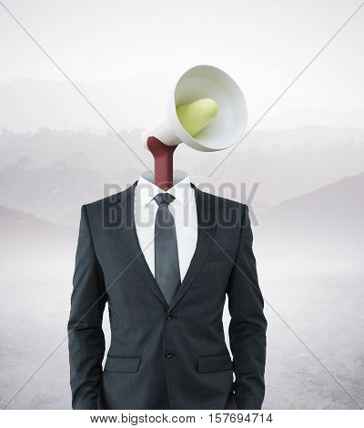 Loud speaker headed businessman on landscape background. Communication voice and power concept