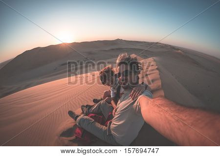 Adult Couple Taking Selfie On Sand Dunes In The Namib Desert, Namib Naukluft National Park, Main Tra