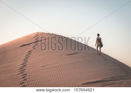 Tourist Walking On The Scenic Dune 7 At Walvis Bay, Namib Desert, Namib Naukluft National Park, Nami