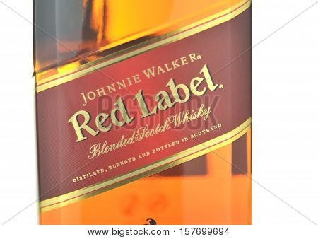 CIRCA NOVEMBER 2016 - GDANSK: Johnnie Walker Red Label blended whisky isolated on white background. Johnnie Walker was established in 1820 in Kilmarnock, Scotland.