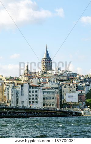 Istanbul Turkey - July 26 2016: Galata Bridge and Galata Tower in the background Istanbul views. This is a great place to see the colors of Istanbul at . Interesting to see the fishermen on the bridge with the Galata tower in the background. There are lot