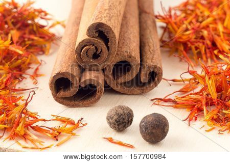 Cinnamon Sticks, Aromatic Saffron And Pimento