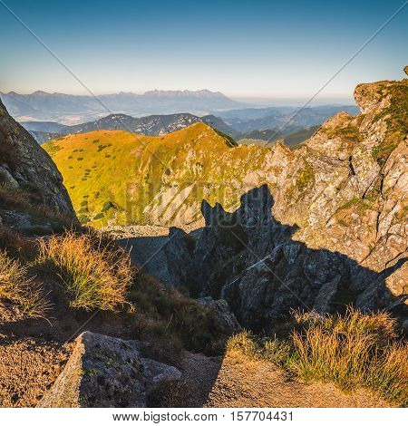 Mountain Landscape in Light of Setting Sun. View from Mount Dumbier in Low Tatras Slovakia. High Tatras Mountains in Background.