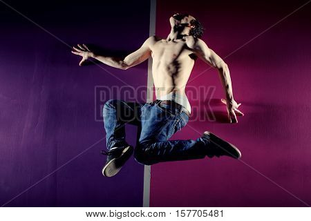Man in motion on pink background studio shot