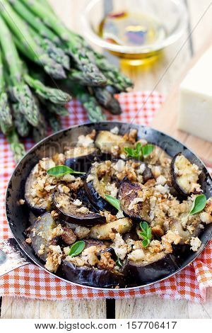 Eggplants aubergines sautéed and pan-fried with breadcrumbs and cheese