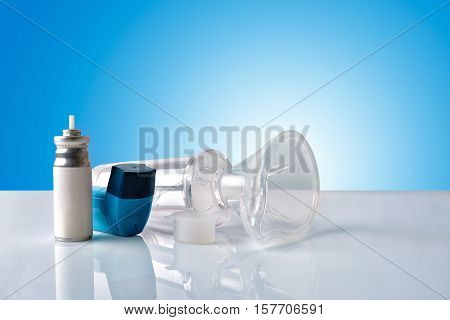 Cartridge Inhaler And Chamber And Mask With Blue Background Front